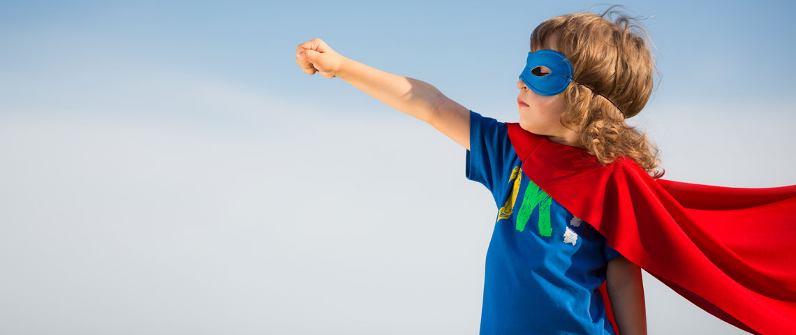 Child dressed up in a superhero outfit